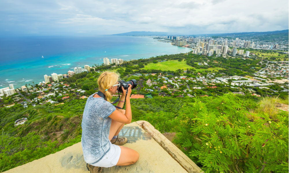 Travel photographer takes a shot of Honolulu and Waikiki beach, Oahu in Hawaii from Diamond Head State Monument.