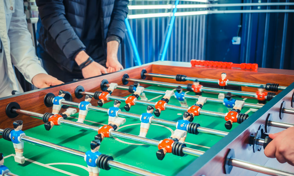 image of active people playing foosball