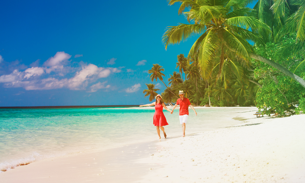 happy loving couple enjoy tropical beach