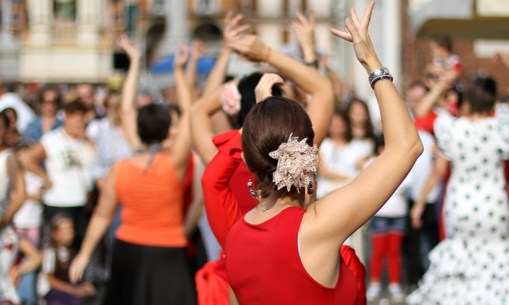 woman dressed in red dancing with a group of people