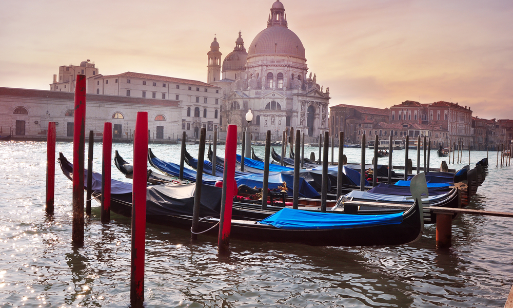 Gondolas on the canal in Venice and Santa Maria della Salute church in the background