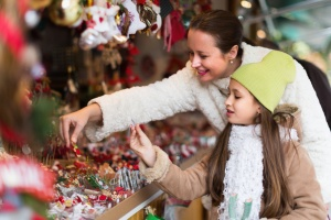 woman and young girl at a holiday market