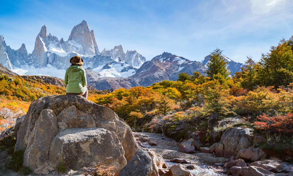 Outdoorsy woman sitting on rock in Patagonia, Argentina