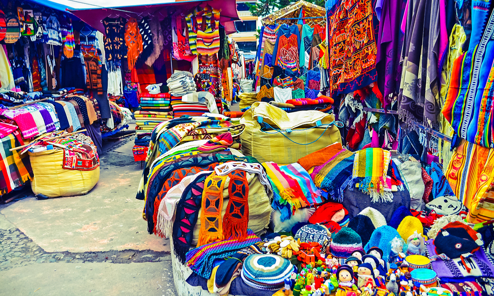 Colorful handmade handicrafts of different colors in indian market of Otavalo in Ecuador