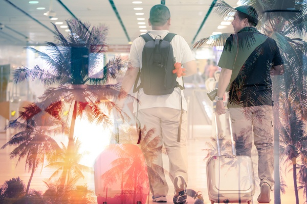 men traveling with palm trees in background