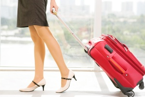 young businesswoman with baggage in airport