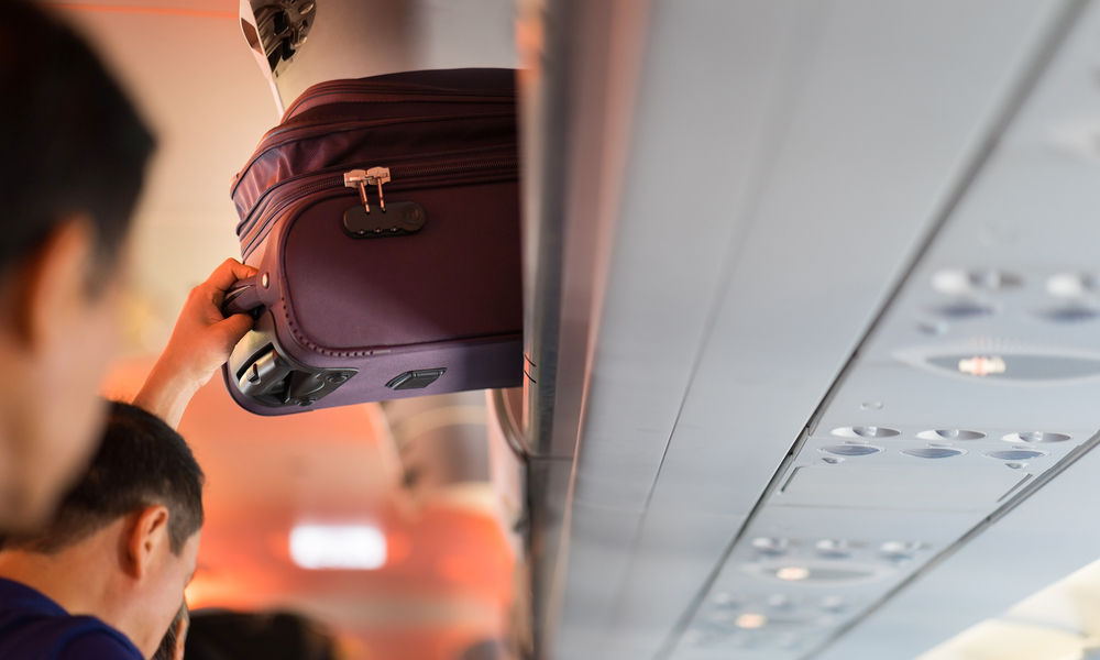 Baggage is pulled out of cabin on airplane