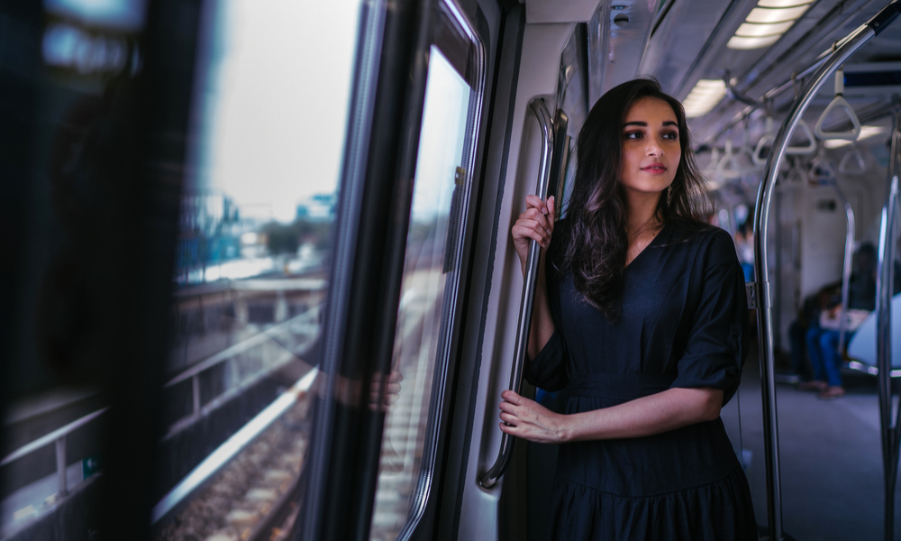 Indian Asian woman taking the train alone