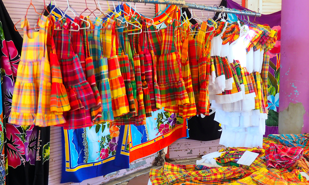 stand selling dresses made of madras on a market in Martinique.