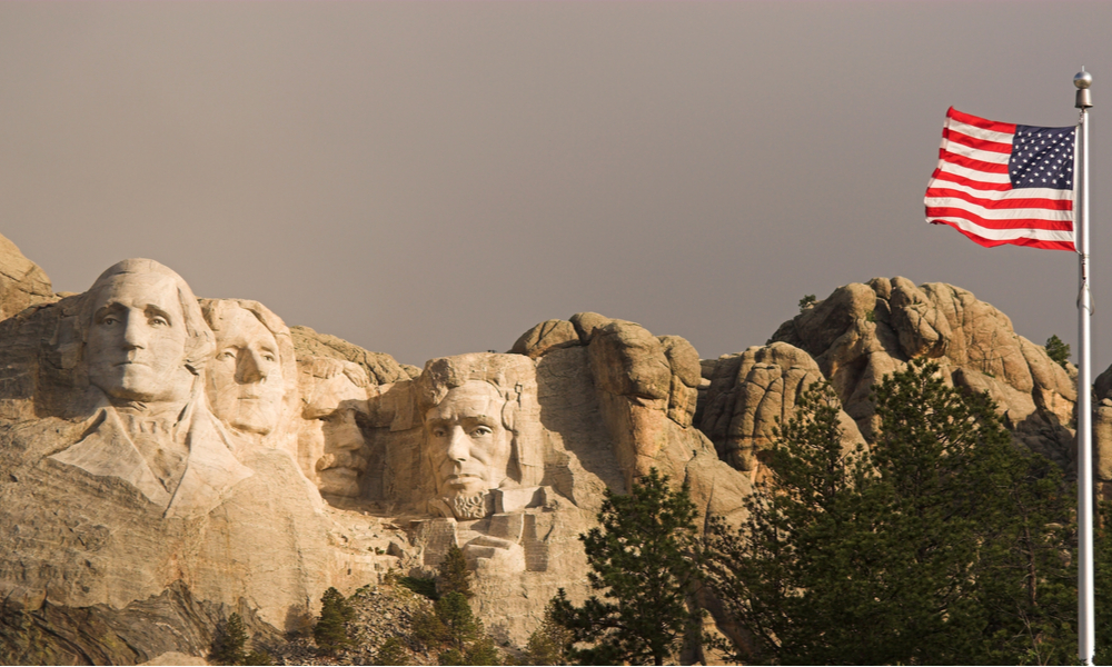 Mount Rushmore and the flag of the United States