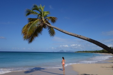 Woman on the beach in Martinique island