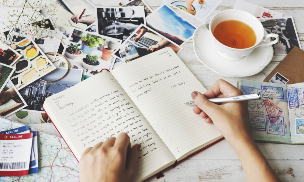 traveler writing in a journal