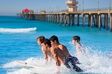 men surfing on huntington beach CA