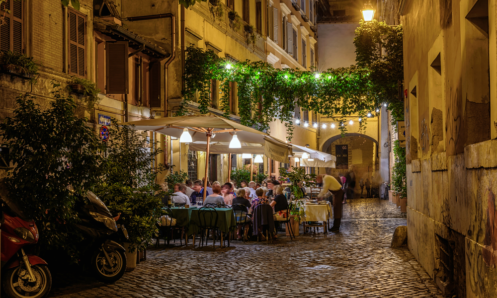 Night view of old cozy street in Trastevere in Rome, Italy.