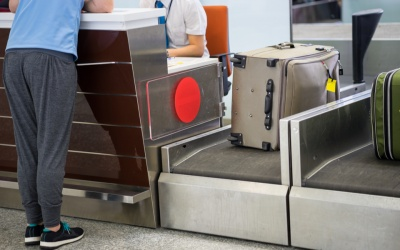 Luggage weighting at check-in desk at Asia airport