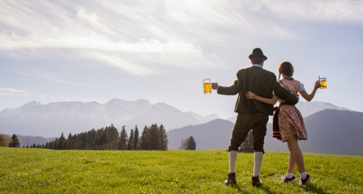 two people dressed for Oktoberfest on mountain
