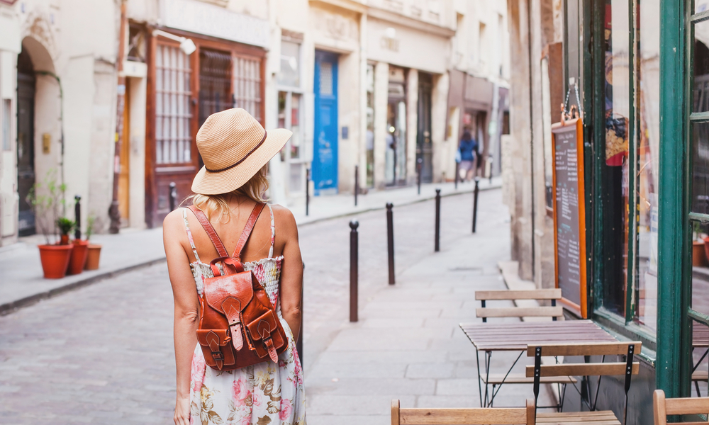 how to stay safe abroad: woman tourist walking on the street in Europe