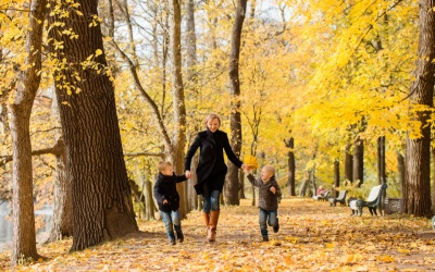 the best fall family vacations: family enjoying a fall destination