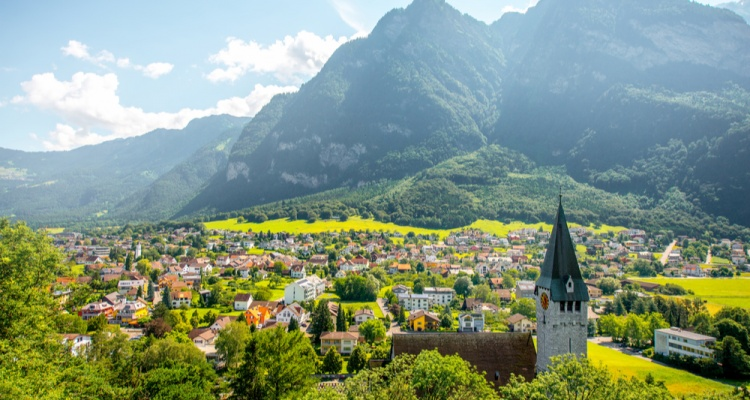 Things to do in liechtenstein: Landscape view on Balzers village with saint Nicholas church in Liechtenstein
