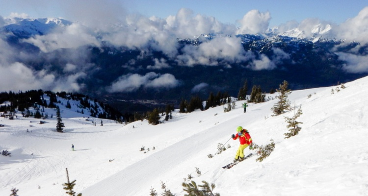The Best Ski Towns That Also Have Beautiful Landscapes:a skier on whistler slope, BC, Canada
