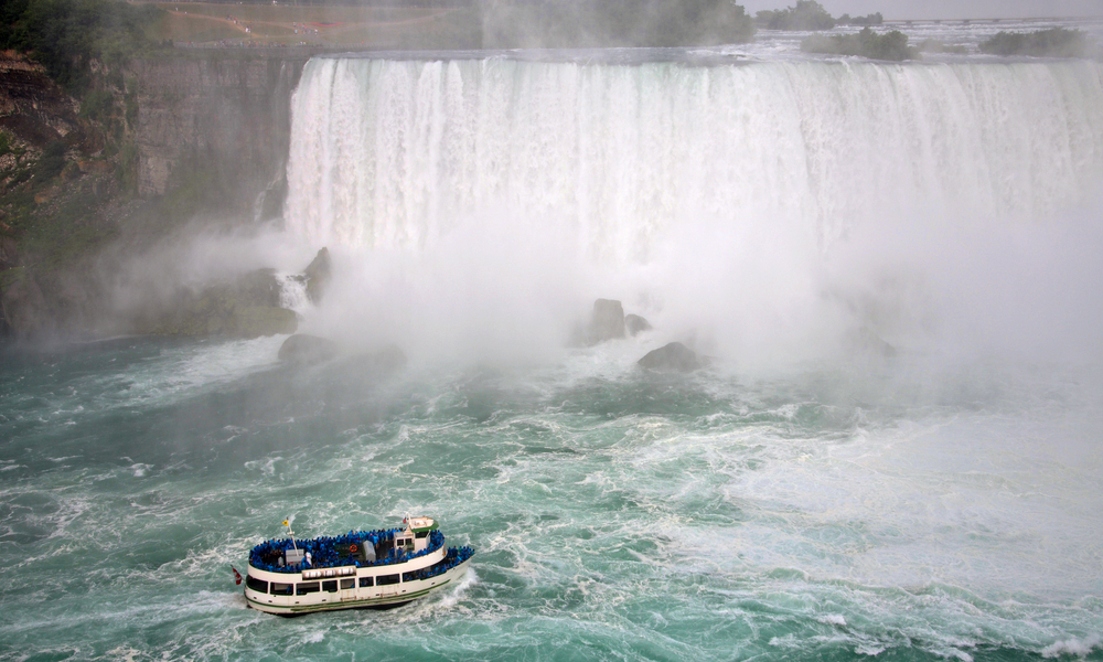 The best fall family vacations: Maid of the Mist at the bottom of American Falls in Niagara Falls, New York State, USA.