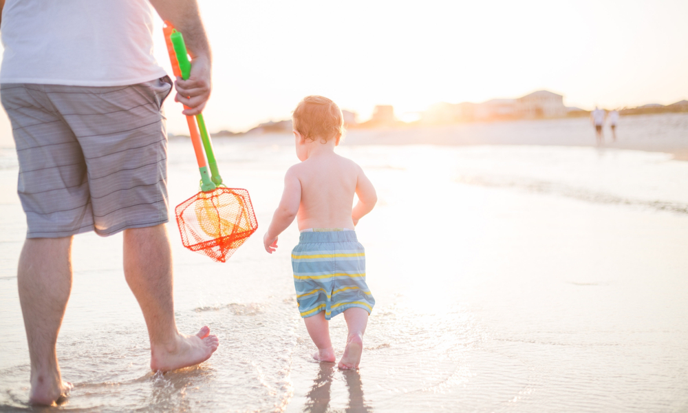 The best fall family vacations: Beach vacation with father and son on beach