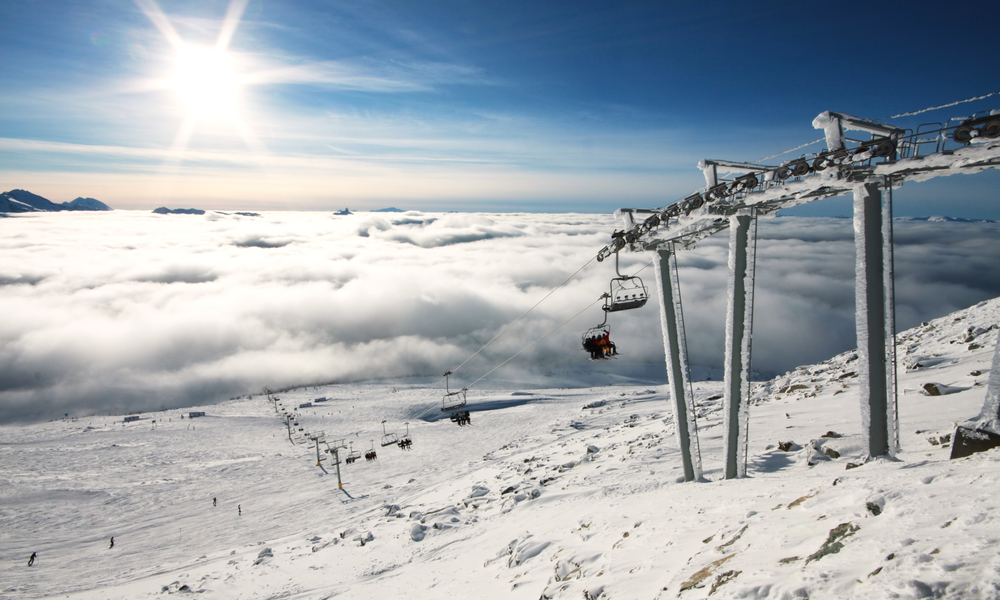 The Best Ski Towns That Also Have Beautiful Landscapes:Heavy fog covers the lower mountain while the alpine is bathed in glorious sunshine in Whistler, BC, site of the 2010 winter Olympic Games.