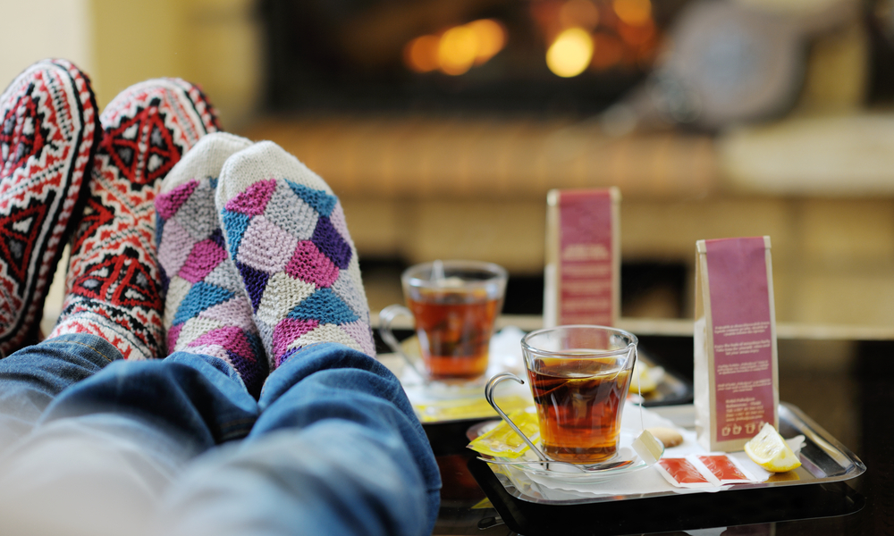 happy Young romantic couple and relaxing sofa in front of fireplace at winter season