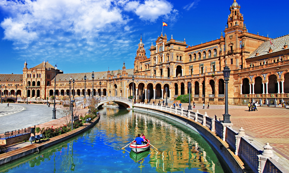 The Best Winter Getaways Where You Can Forget the Cold: beautiful Plaza de Espana, Sevilla, Spain