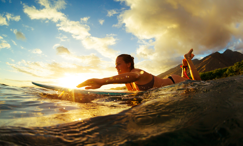 The Best Places to Surf in Hawaii in the Winter Season: Surfing at Sunset.