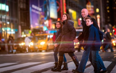 things to do in new york with kids: Family crossing Broadway in Times Square, New York City