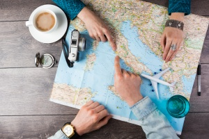 How to Plan a Vacation: Guys Planning with Map