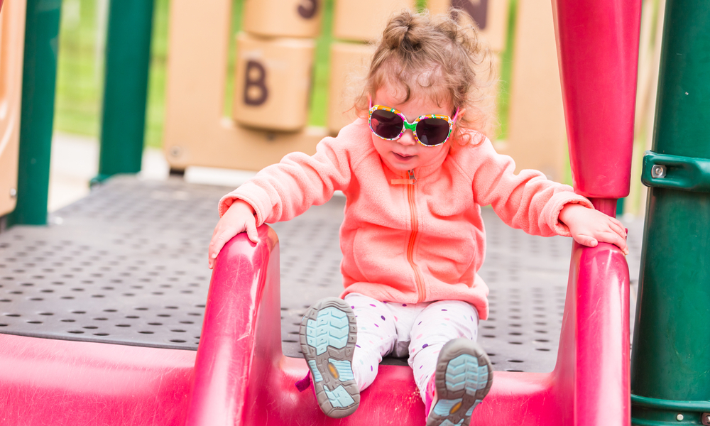 Best Free Things You Can Do in Denver with Kids: Toddler playing at the playground in urban park.