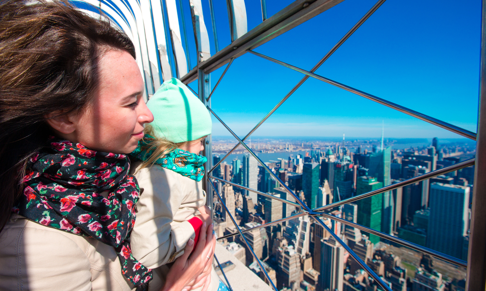 things to do in new york with kids: Family enjoy view to New York City from Empire State Building