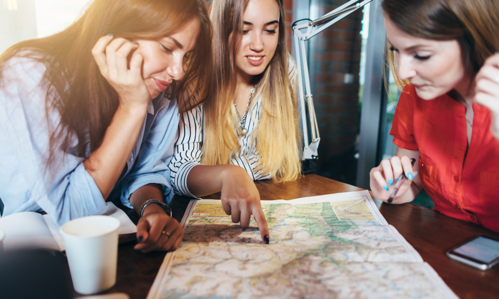 How To Plan a Vacation: Girls Planning with a Map
