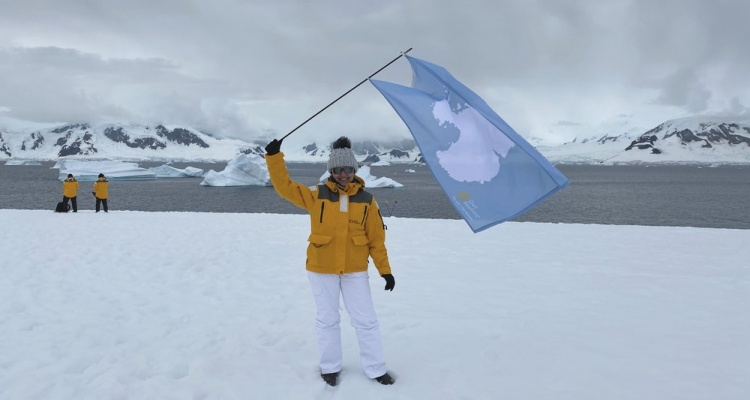 how to get to antarctica: waving the antarctica flag on the continent