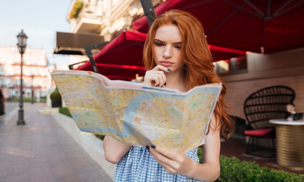 Girl lost and using map