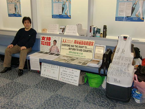 China protestor and citizen sits in Japan's Narita Airport