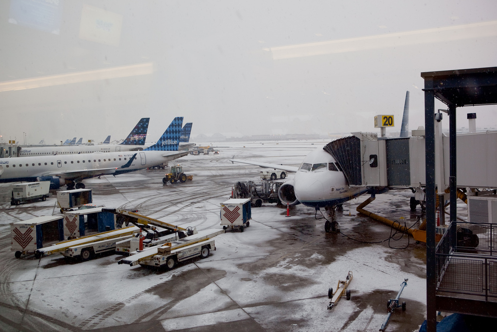 Snowy airport with JetBlue planes