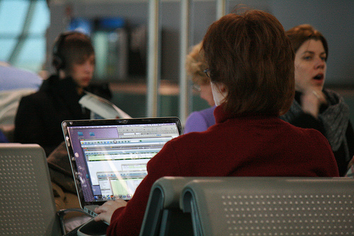 """Working while waiting for plane,"" CC Flickr photo credit: jepoirrier"