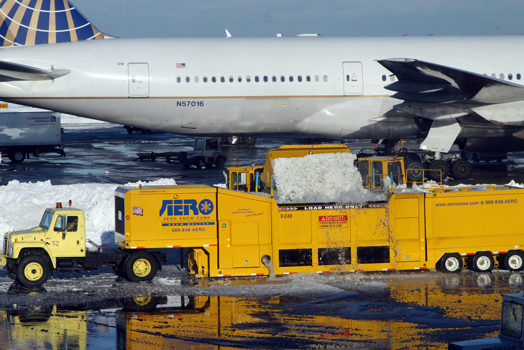 Workers use melters to clear snow from the runway (Flickr:  Nfrastructure)