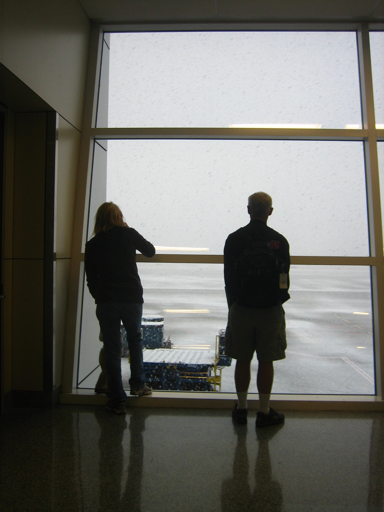Travelers inspect the weather outside of DFW (Flickr: adactio)