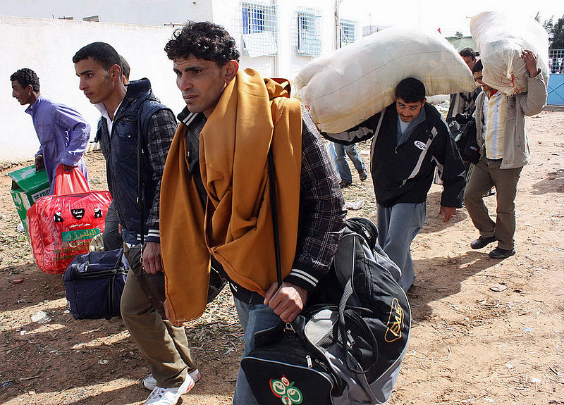 Libyan refugees arrive at the Tunisia border (Image: Wikimedia)