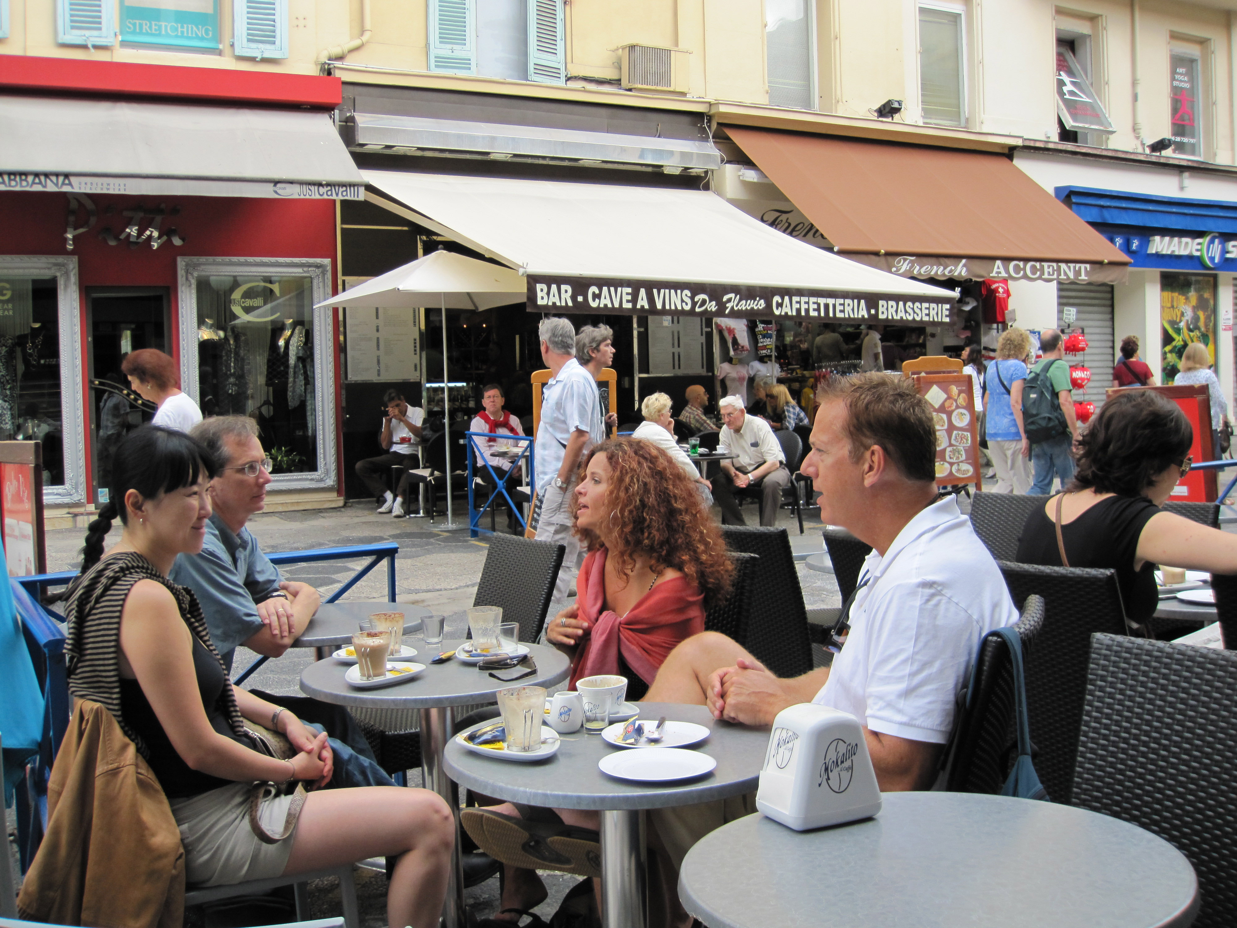 Visitors to Nice, France enjoy lunch with locals