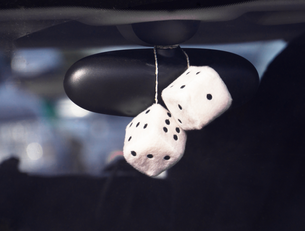 dice hanging from rear view mirror