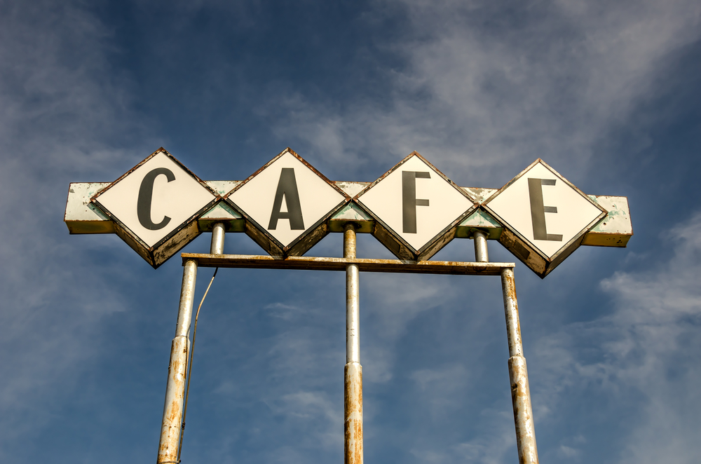 Large, generic sign for a cafe on Route 66.