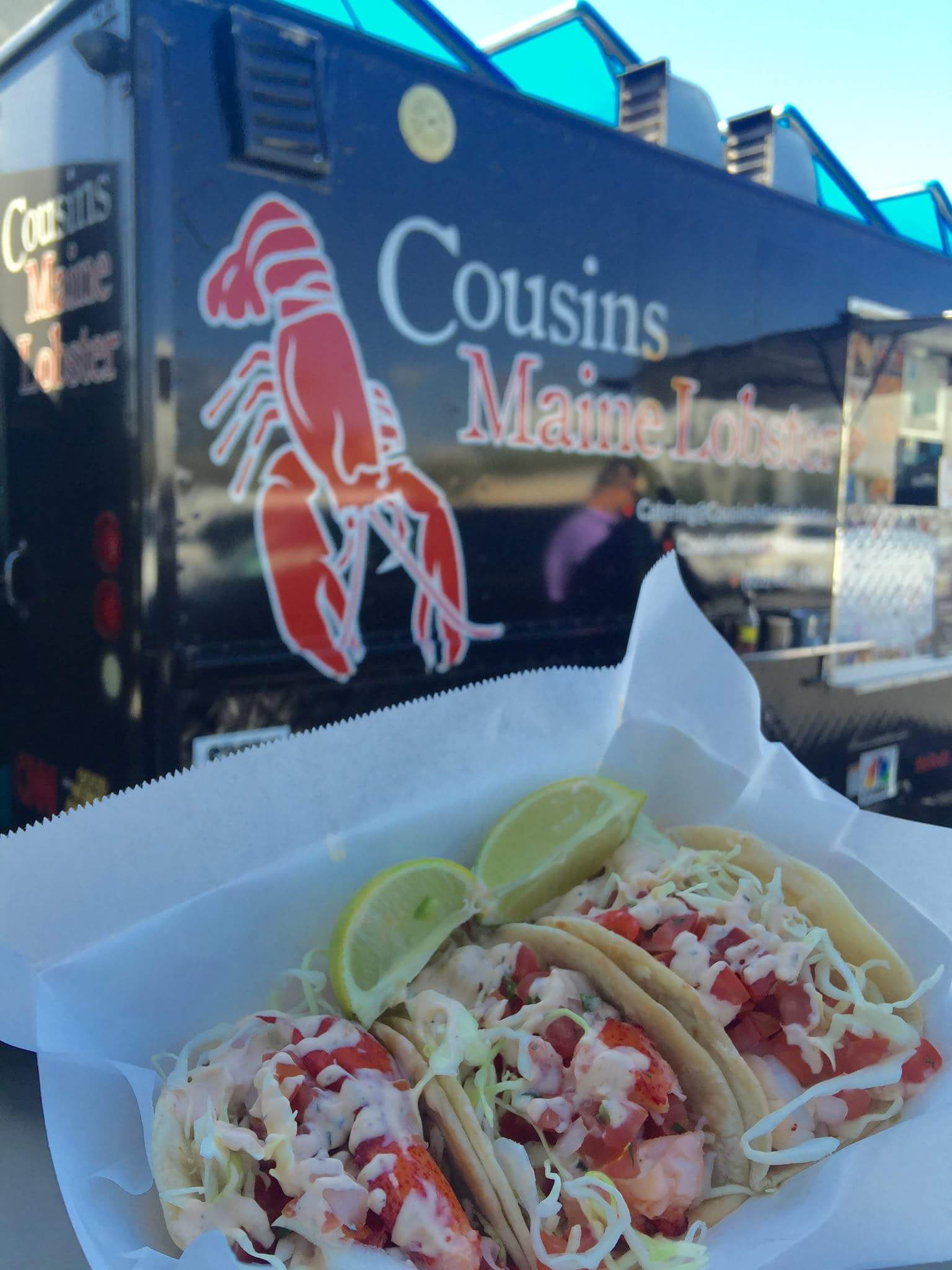Freshly made lobster rolls in front of food truck