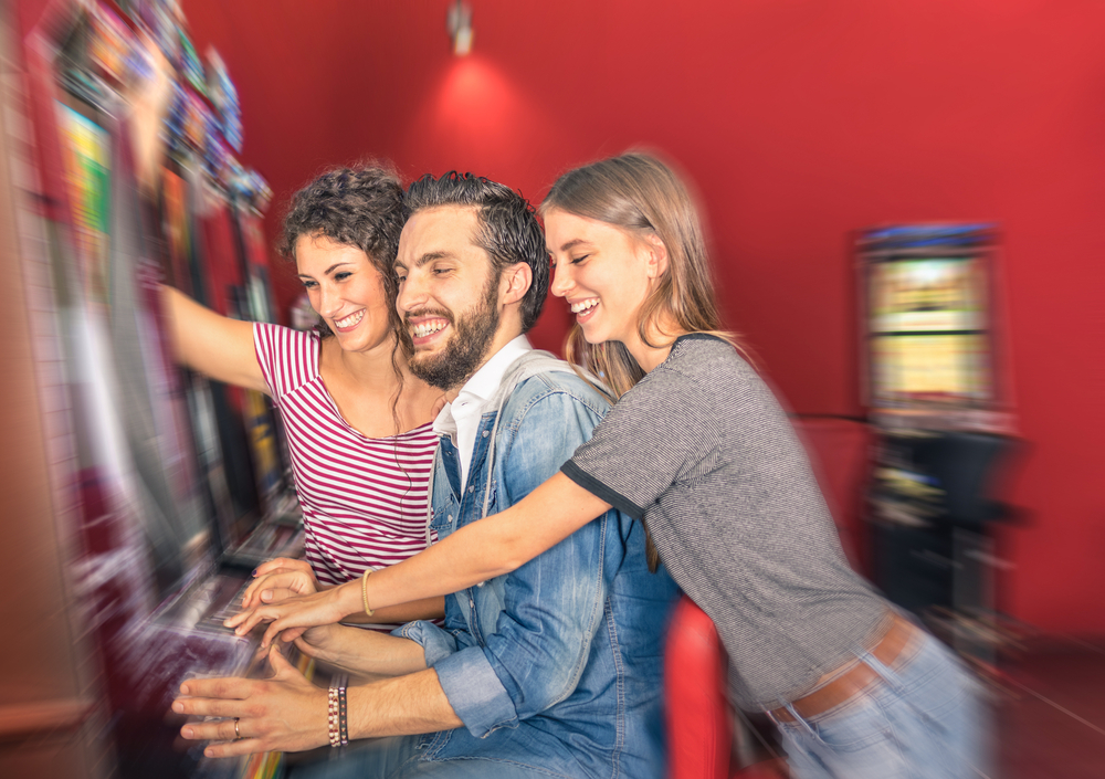 Friends Enjoying a Slot Machine