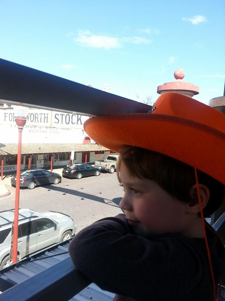 Liam waiting for the longhorns to march during the daily cattle drive at the Fort Worth Stockyards