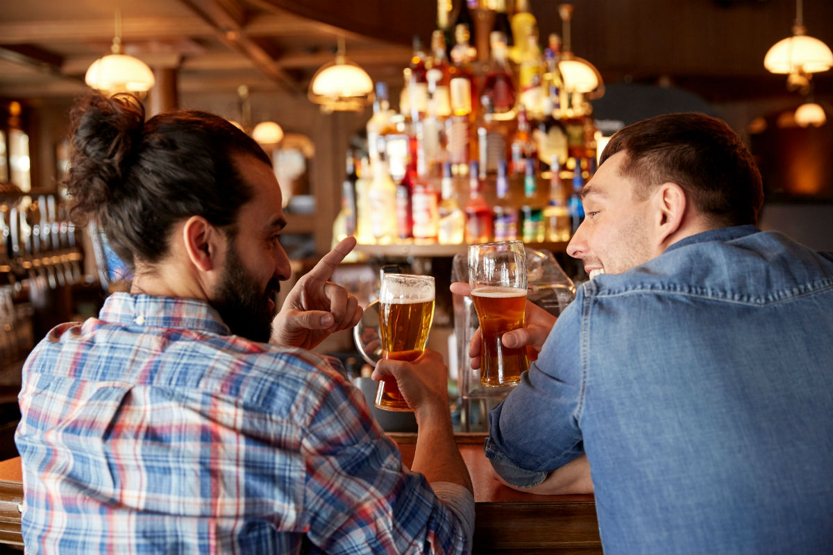 Two young men drinking at the bar